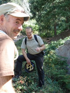 Osprey's Sam Mix is all smiles while volunteering, while Eldorado Canyon's head trail director, Mick McHugh shares important information about the trail with the volunteers.