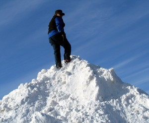 arriving at top of pile of snow