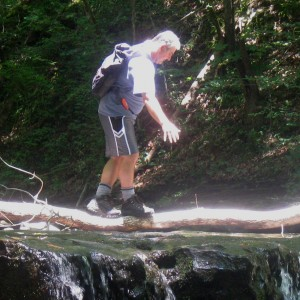 Crossing a log wearing the Compass boots