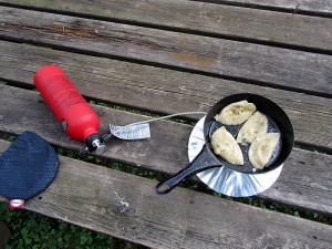 cooking pot stickers in a porcelain pan