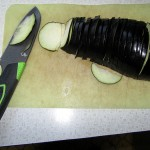 eggplant cut in slices with Gerber Camp Kitchen knife Gerber Camp Kitchen knife