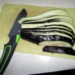 eggplant cut in slices lengthwise with Gerber Camp Kitchen knife