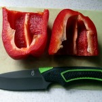 Gerber Camp Kitchen knife with red bell pepper cut in halves